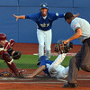 He's safe!: Terre Haute's Nick Johnson, background, offers his own call on teammate Michael Schroeder's slide into home plate during the Rex' game against Danville Saturday at Sycamore Stadium. Schroeder was called out.