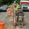 Tribune-Star/Joseph C. Garza<br /> Removing the remnants of the rails: Jim Schaefer of the Penhall Company out of Indianapolis operates a saw to cut into Wabash Avenue Tuesday as part of a rail removal project.
