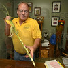 Tribune-Star/Joseph C. Garza<br /> Test stalk: Jim Luzar of the Purdue University Vigo County Extension Office shows the stalk of corn he conducted a quick nitrate test on Tuesday in his office.