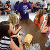 Tribune-Star/Jim Avelis<br /> Personal contact: New Otter Creek Middle School principal Tammy Rowshandel talks with a group of eighth graders during their lunch break on their first day of school.