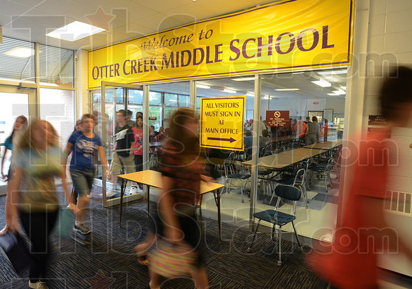 Tribune-Star/Jim Avelis<br /> All a blur: Otter Creek Middle School eighth graders leaves the cafeteria after their lunch on the first day of school.