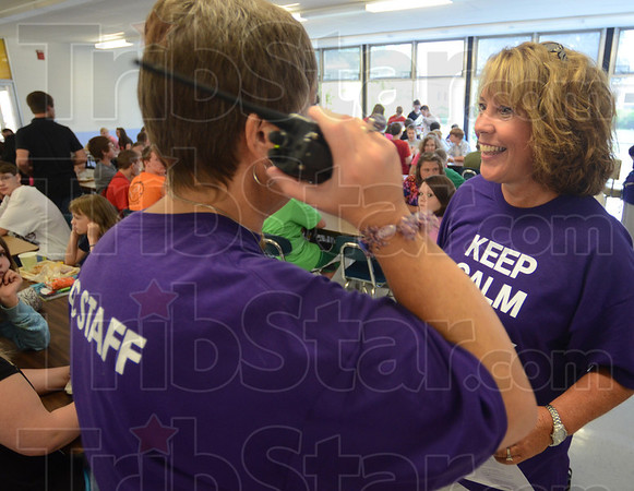 Tribune-Star/Jim Avelis<br /> Teamwork: New Otter Creek Middle School principal Tammy Rowshandel listens in to handheld radio traffic as she talks with new dean Meg Merrill. Tuesday was the first day of school for Vigo County School students.