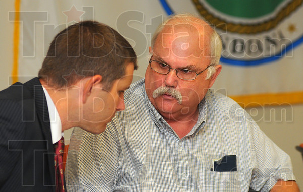 Tribune-Star/Jim Avelis<br /> Let's talk: Attorney Michael Wright talks with Vigo County commissioner Mike Ciolli during the weekly commissioners meeting Tuesday morning. About 30 Woodgate residents were present, voicing their opposition to continued construction of multiple family housing at Cobblestone Crossing.