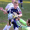 Tribune-Star/Jim Avelis<br /> Stopped: West Vigo goal keeper Nathan Augustus stops a kick by Terre Haute North's Kaden Slaon. Sloan had earlier scored the Patriot's first goal of the match.