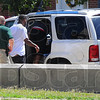 Tribune-Star/Jim Avelis<br /> Safe passage: Family members of shooting victim Dustin Kelly are escorted to a waiting vehicle after a disturbance in the Vigo County courthouse.