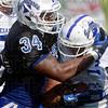 Tribune-Star/Joseph C. Garza<br /> Wrap 'em up: Indiana State linebacker Jacolby Washington (34) wraps up teammate J.D. Pride during team practice Monday at Memorial Stadium.