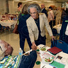 Tribune-Star/Joseph C. Garza<br /> Keynote speaker: Retired circuit-court judge Viola Taliaferro greets Deborah Hearn-Smith, chief executive officer of the Girl Scouts of Central Indiana, as Becky Buse, director of advocacy and community development looks on during the Women's Equality Day luncheon Tuesday at the Girl Scouts of Central Indiana office.