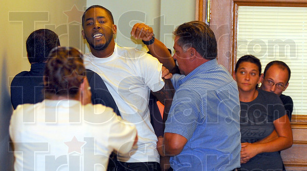 Tribune-Star/Jim Avelis<br /> Restrained: Brandon Brown, brother of shooting victim Dustin Kelly, is restrained by law enforcement officers in the Vigo County courthouse. He was at a hearing for alleged shooter William Mallory.
