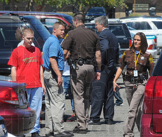 Tribune-Star/Jim Avelis<br /> Quiet for now: Several law enforcement officers were present shortly after a disturbance inside the Vigo county courthouse worked its way outside into the parking lot.