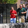 Tribune-Star/Jim Avelis<br /> Reinforcements: Law enforcement officers run to eh Vigo County Courthouse parking lot Tuesday afternoon. A dispute surrounding a hearing for alleged shooter William Mallory erupted in the courthouse and carried over to the parking lot.