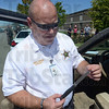 Tribune-Star/Jim Avelis<br /> Contraband: Vigo County Sheriff Greg Ewing holds a knife that was found during the disturbance outside the Vigo County courthouse Tuesday afternoon.