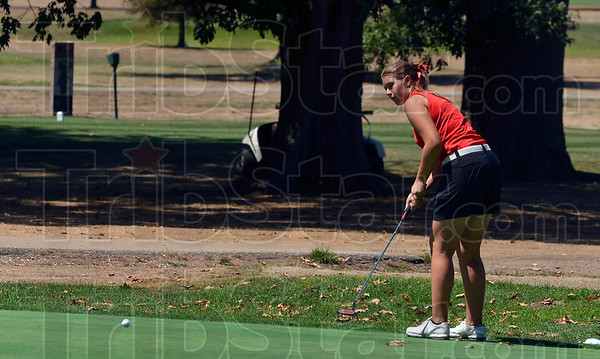 Tribune-Star/Joseph C. Garza<br /> Keep rollin': Terre Haute South's Alexandra Pickens watches her putt roll towards the cup on the second hole at Rea Park Tuesday.