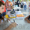 Autograph: Austin Evans signs an autograph for five-year-old Adam Scank of Terre Haute during Tuesday's National Night Out.