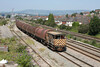10 August 2012 :: Departing from  East Usk Yard. 66124 propells a train of covered steel carriers to the docks on the eastern side of Newport producing the rare sight of a brake van being used in 2012