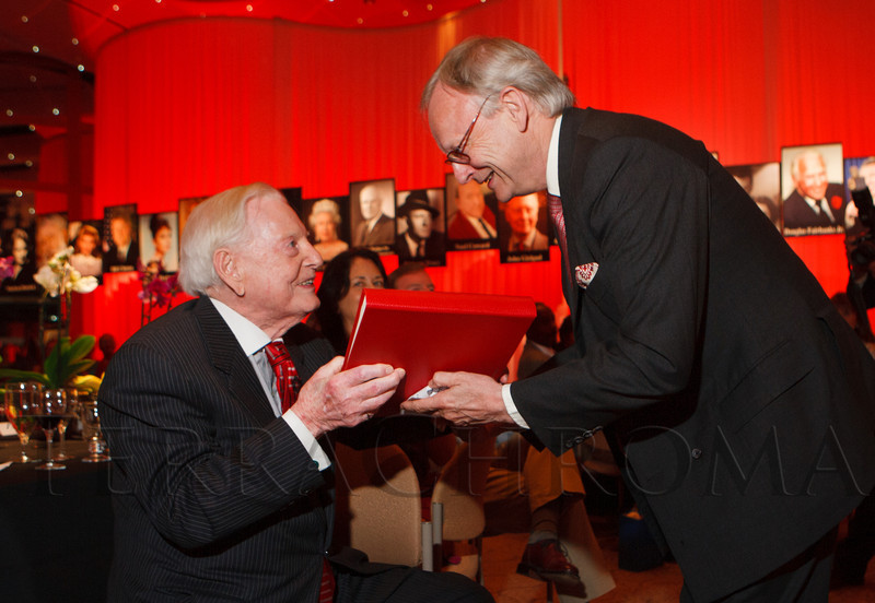 Lord Deben presents a book of letters to Donald Seawell.  Celebration of Donald R. Seawell's 100th birthday at the Donald R. Seawell Grand Ballroom, Denver Center for Performing Arts, in Denver, Colorado, on Wednesday, Aug. 1, 2012.<br /> Photo Steve Peterson