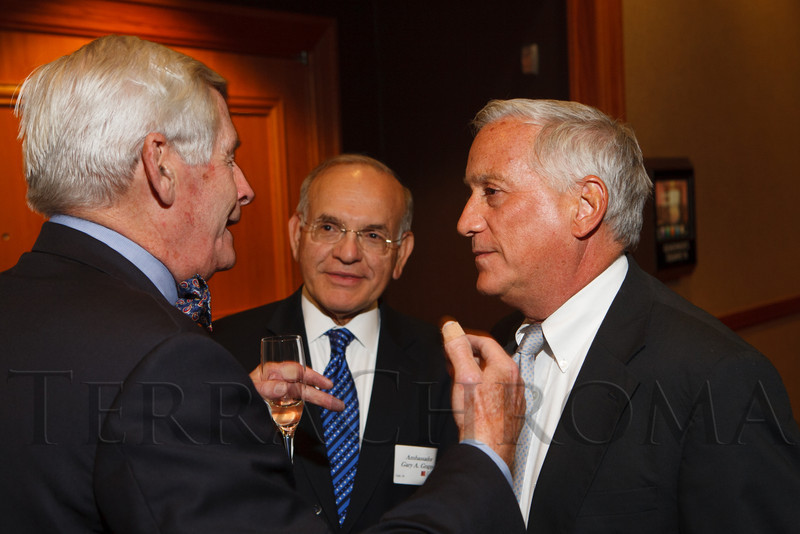 Bob Downey, Ambassador Gary A. Grappo, and Walter Isaacson.  The Fifteenth Annual Korbel Dinner, benefiting the Josef Korbel School of International Studies, at the Sheraton Denver Downtown Hotel in Denver, Colorado, on Wednesday, Aug. 15, 2012.<br /> Photo Steve Peterson