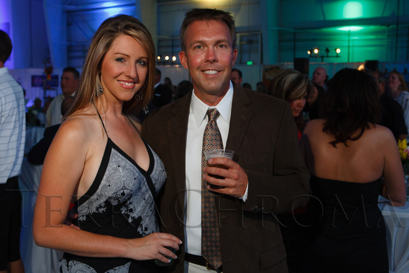 """Amelia Earhart and Chad Graves.  """"SaddleUp! and Pack Your Bags"""" event, benefiting the SaddleUp! Foundation at the Mayo Aviation Hangar, Centennial Airport, in Centennial, Colorado, on Friday, Aug. 17, 2012.<br /> Photo Steve Peterson"""