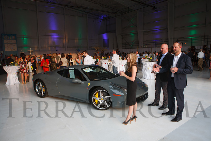 "Cars displayed by Ferrari of Denver.  ""SaddleUp! and Pack Your Bags"" event, benefiting the SaddleUp! Foundation at the Mayo Aviation Hangar, Centennial Airport, in Centennial, Colorado, on Friday, Aug. 17, 2012.<br /> Photo Steve Peterson"