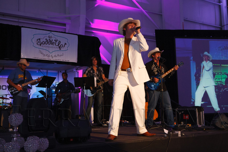 "Richie Law is the first performer.  ""SaddleUp! and Pack Your Bags"" event, benefiting the SaddleUp! Foundation at the Mayo Aviation Hangar, Centennial Airport, in Centennial, Colorado, on Friday, Aug. 17, 2012.<br /> Photo Steve Peterson"