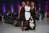 "Sue Ellen Goss, Shery (Bear) McDonald-Galbreath, and Linda Goto, with Bernice the Bernese mountain dog.  ""SaddleUp! and Pack Your Bags"" event, benefiting the SaddleUp! Foundation at the Mayo Aviation Hangar, Centennial Airport, in Centennial, Colorado, on Friday, Aug. 17, 2012.<br /> Photo Steve Peterson"