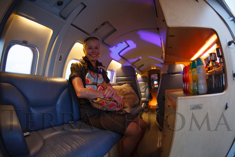 """Kay Chernoff tries out the Westwind jet.  """"SaddleUp! and Pack Your Bags"""" event, benefiting the SaddleUp! Foundation at the Mayo Aviation Hangar, Centennial Airport, in Centennial, Colorado, on Friday, Aug. 17, 2012.<br /> Photo Steve Peterson"""