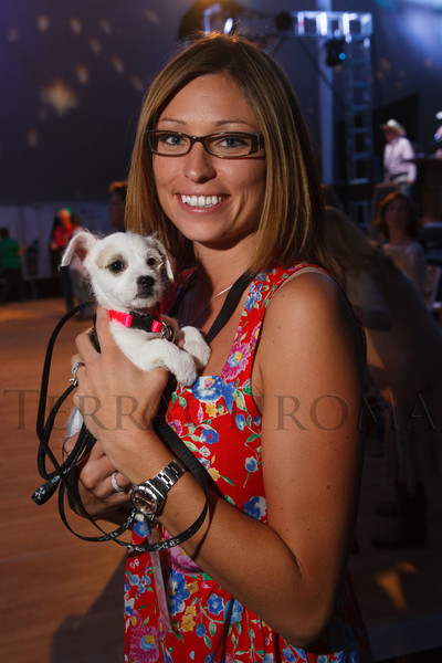 Marcy Hebbelinck adopted Lena, a terrier mix.  Lulu's Barkin' BBQ, benefiting the Dumb Friends League Buddy Center in Castle Rock, Colorado, held at the home of Fred and Jana Bartlit in Castle Pines, Colorado, on Saturday, Aug. 18, 2012.<br /> Photo Steve Peterson