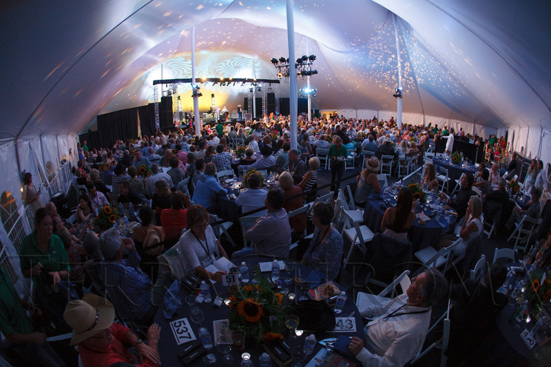 Dinner and live auction inside the main tent.  Lulu's Barkin' BBQ, benefiting the Dumb Friends League Buddy Center in Castle Rock, Colorado, held at the home of Fred and Jana Bartlit in Castle Pines, Colorado, on Saturday, Aug. 18, 2012.<br /> Photo Steve Peterson