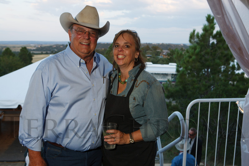 Tom and Lisa Perini.  Lulu's Barkin' BBQ, benefiting the Dumb Friends League Buddy Center in Castle Rock, Colorado, held at the home of Fred and Jana Bartlit in Castle Pines, Colorado, on Saturday, Aug. 18, 2012.<br /> Photo Steve Peterson