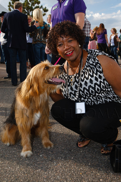 Ryta Sondergard with Leena, a terrier mix.  Lulu's Barkin' BBQ, benefiting the Dumb Friends League Buddy Center in Castle Rock, Colorado, held at the home of Fred and Jana Bartlit in Castle Pines, Colorado, on Saturday, Aug. 18, 2012.<br /> Photo Steve Peterson