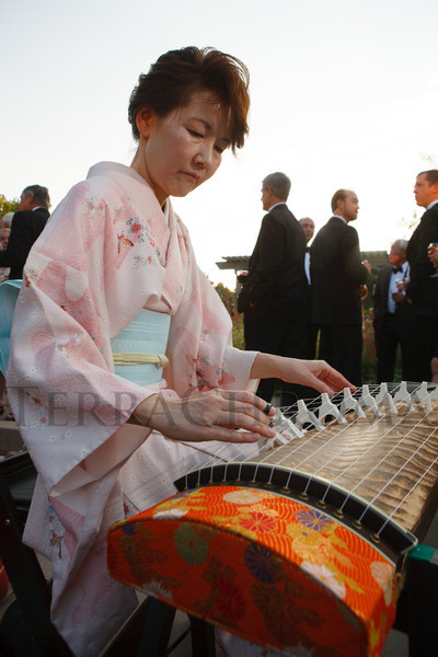 Junko Shigetea plays the koto.  Fete des Fleurs, benefiting the Denver Botanic Gardens, at the Denver Botanic Gardens in Denver, Colorado, on Friday, Aug. 24, 2012.<br /> Photo Steve Peterson