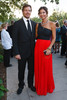 Bart Bansbach and Nicole Lloyd (Alexie dress, jewelry from Goldyn in Denver, purse CC Skye).  Fete des Fleurs, benefiting the Denver Botanic Gardens, at the Denver Botanic Gardens in Denver, Colorado, on Friday, Aug. 24, 2012.<br /> Photo Steve Peterson