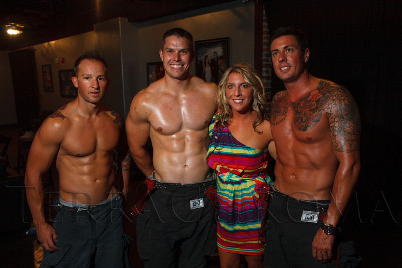 Chris Zienkievicz, Colt Smith, Kristi Pohly (CF marketing and events), and Tom Martinez.  The 2013 Colorado Firefighter Calendar Debut Party at Mile High Station in Denver, Colorado, on Friday, Aug. 24, 2012.<br /> Photo Steve Peterson