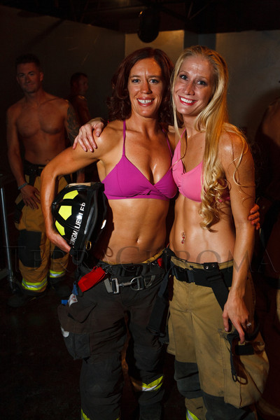 Jenny Klingmueller and Rebedca Clark.  The 2013 Colorado Firefighter Calendar Debut Party at Mile High Station in Denver, Colorado, on Friday, Aug. 24, 2012.<br /> Photo Steve Peterson
