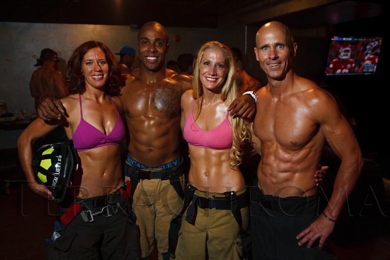 Jenny Klingmueller, Anthony Ramsey, Rebecca Clark, and Tony Cardenas.  The 2013 Colorado Firefighter Calendar Debut Party at Mile High Station in Denver, Colorado, on Friday, Aug. 24, 2012.<br /> Photo Steve Peterson