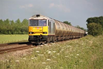 60099 1803/6E41 Westerleigh-Lindsey passes Halsham Crossing