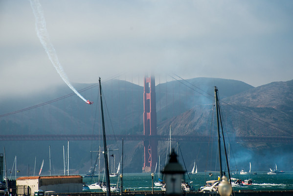 Oracle's stun plane in front of the Golden Gate Bridge
