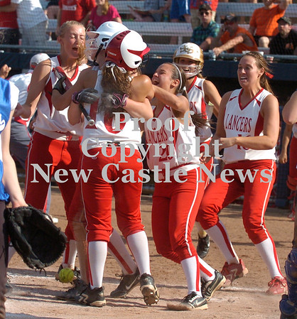 Erica Galvin/NEWS<br /> Members of the Neshannock High softball team mob Madison Altmyer, who scored the winning run in the eighth inning to lead the Lady Lancers to a 4-3 win over Warrior Run. Altmyer scored on a passed ball to secure the PIAA Class AA title for Neshannock.