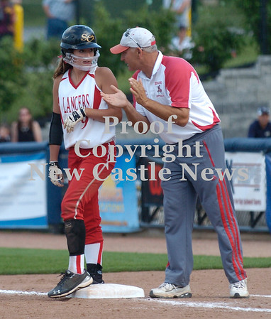 Erica Galvin/NEWS<br /> First base coach James Graziani gives advice to Marissa Dematteo.