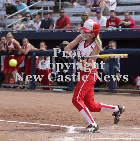 Erica Galvin/NEWS<br /> Madison Shaffer eyes the ball as she slap hits it for a in-the-park homerun in the first inning yesterday.