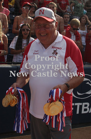Erica Galvin/NEWS<br /> Head Coach Tracy Kimmel shows off the gold medals before the award ceremony.