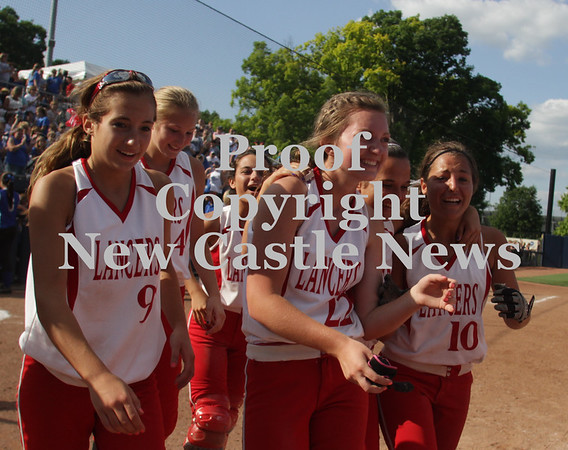 Erica Galvin/NEWS<br /> Lady Lancers from left, Marissa Dematteo, Allie Fischer, Madison Altmyer, Gina Zingaro and Katie Burrelli all surround Altmyer after she scored the winning run in the eighth inning.