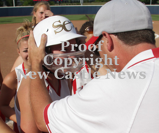 Erica Galvin/NEWS<br /> Assistant Coach Jim Furst talks to Madison Altmyer after scoring the winning run yesterday.