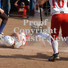 Erica Galvin/NEWS<br /> Madison Altmyer slides safely home as Warrior Run catcher Lynn Vermilya attempts to make the tag in the eighth inning.