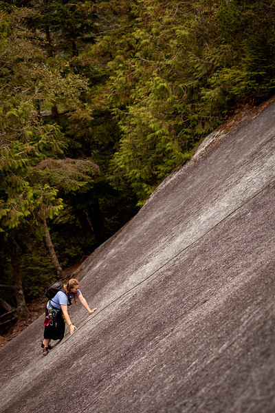 Tracy pads easily up the first slabs of <i>Banana Peel 5.8</i> on the Stawamus Chief.