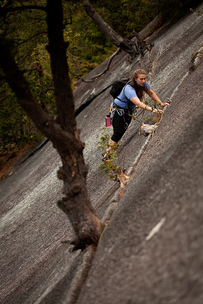 The first pitch of <i>Banana Peel 5.8</i> offers a pleasant slabby traverse for Tracy, low down on the Stawamus Chief.