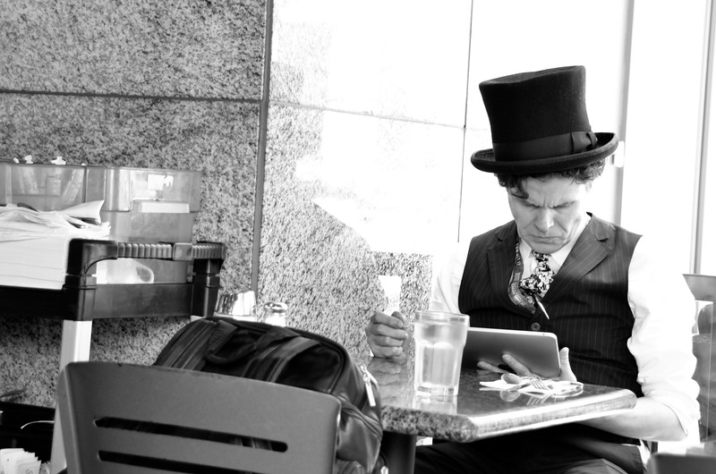 Dapper man with his iPad