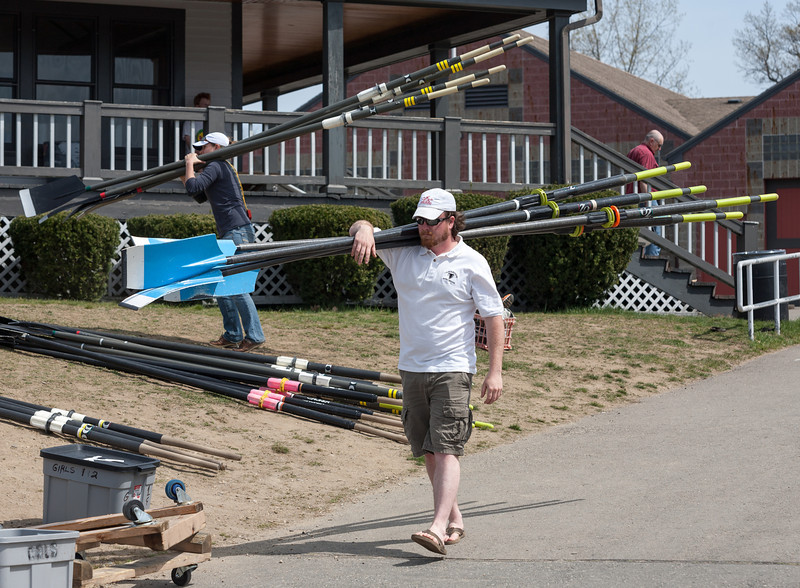 Coach Matt carrying oars