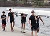 Boys 4th Varsity walking boat off the dock: Susmit, Thomas & Will