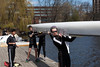 Boys 4V carrying boat on dock