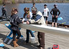 Louisa, Abbie, and Coach Dale working on boat